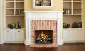 fireplace with brick and mantel surround